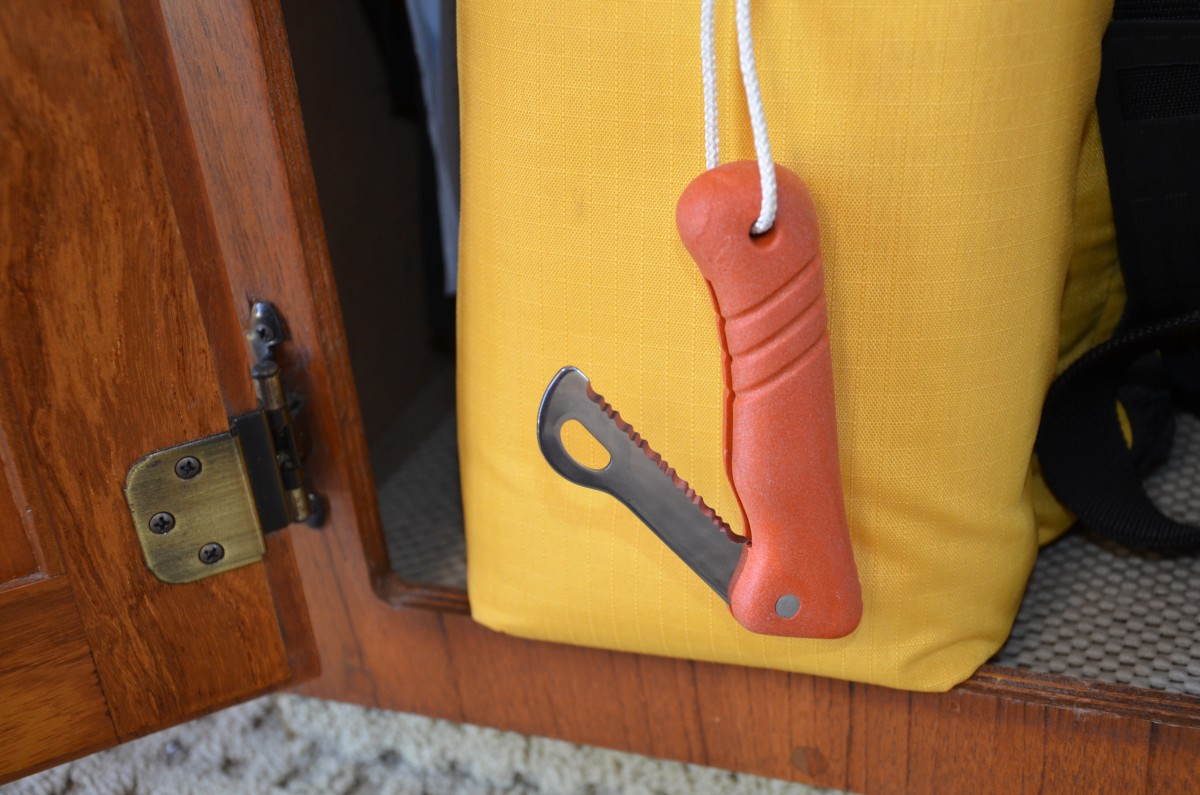 While the inventory of most rafts includes a knife for the express purpose of cutting the painter free from the boat, we also carry this floating knife attached to our abandon ship kit. It has a rounded sheepsfoot tip, to help prevent accidentally puncturing the raft.