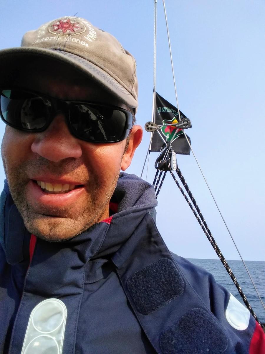 Grand Marais Harbormaster Dave Tersteeg sailing solo at the end of the season.