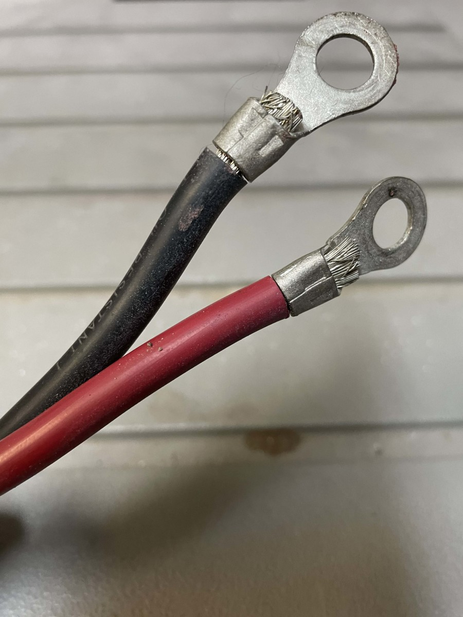 These 8 AWG wires look like they were mashed with a pair of pliers. This is an invitation for moisture and corrosion, assuming the wire doesn't pull out of the crimps from vibration.