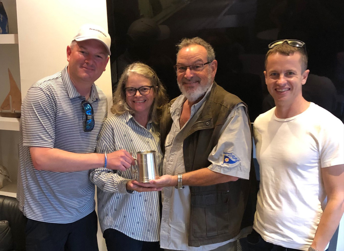 North Pacific 49 Euro owners Rick Ginsburg and Mary Silverstein (center), and North Pacific Yachts President Trevor Brice (right), accept the 2021 Trawlerfest Baltimore People's Choice Award from Trawlerfest Event Manager Ryan Davidson.