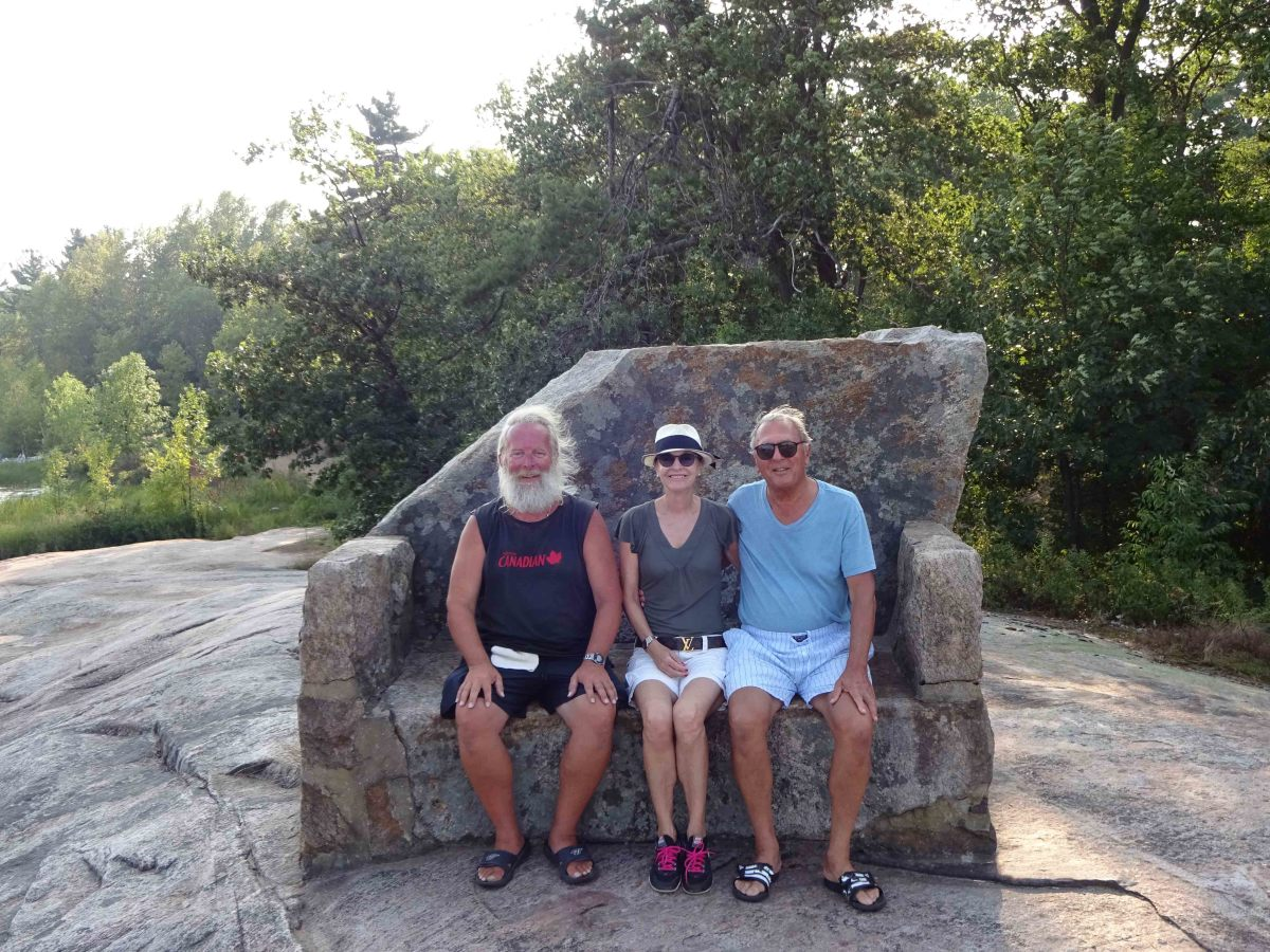 Rosmarie and Rene enjoy the company of fellow cruiser Brian Wilhelm (left) on Beausoleil Island, Midland, Ontario.