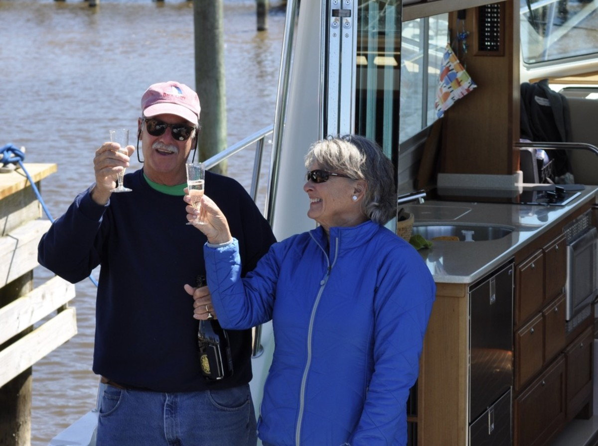 Having arrived safely back at their home port in Albemarle Plantation in North Carolina, Bill and Amy Denison toast to passing their wake.