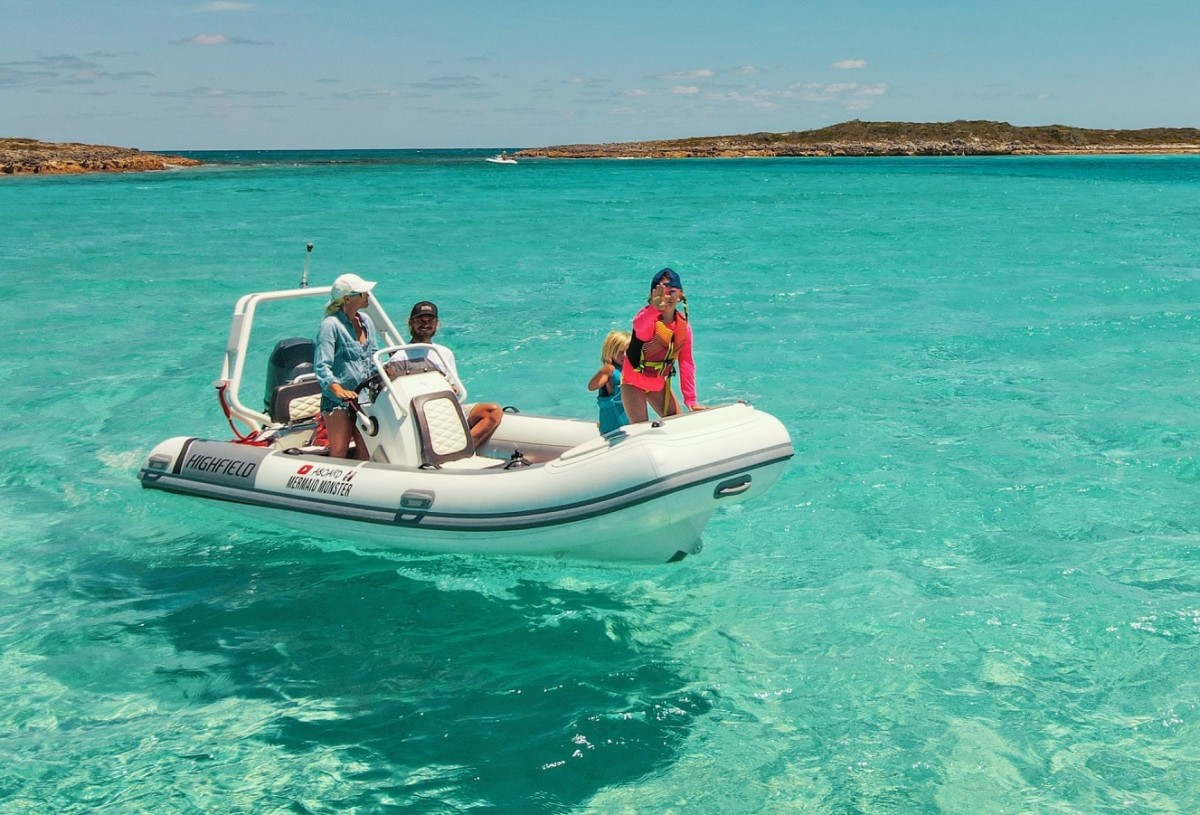 The crew of Aboard Mermaid Monster on their Highfield dinghy in the Bahamas.
