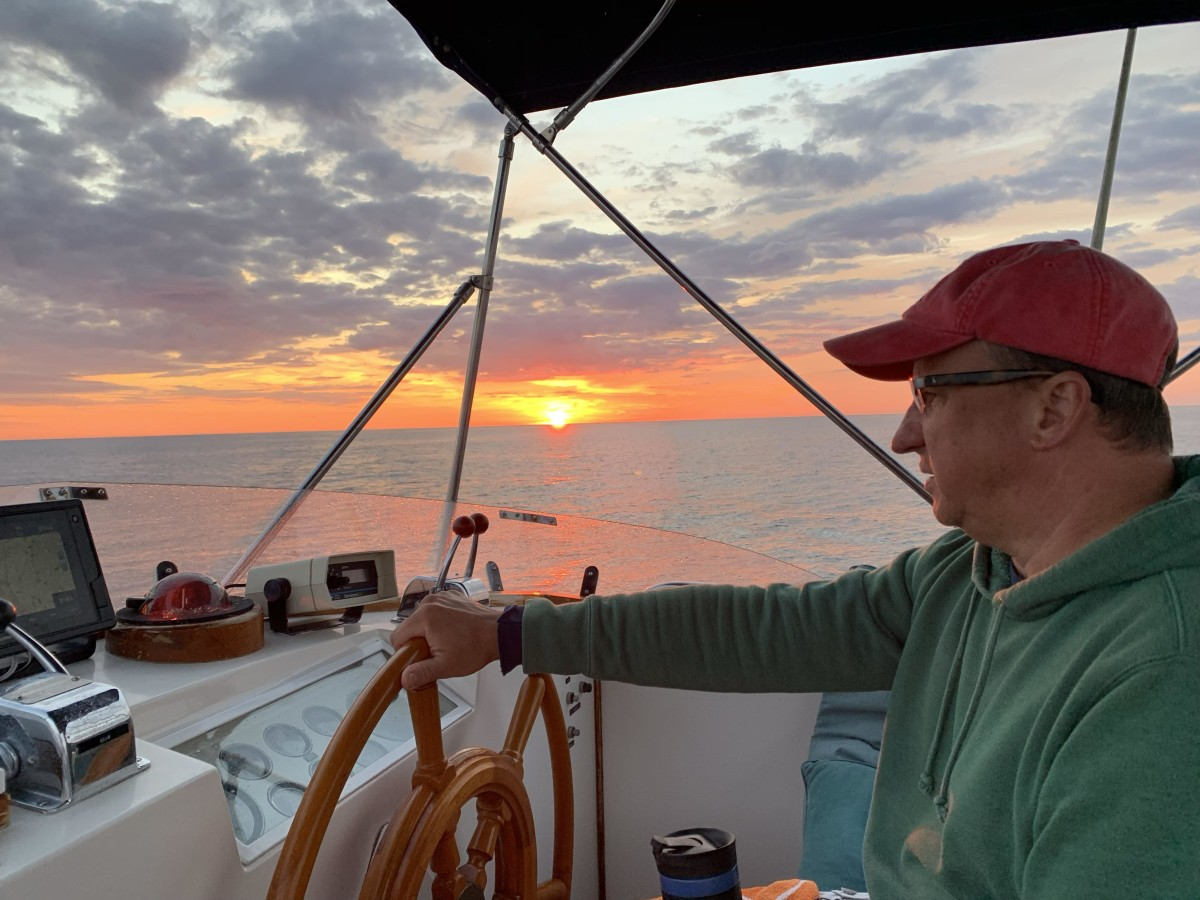 The author enjoys a morning watch off Maine during the initial shakedown delivery from the Great Lakes.