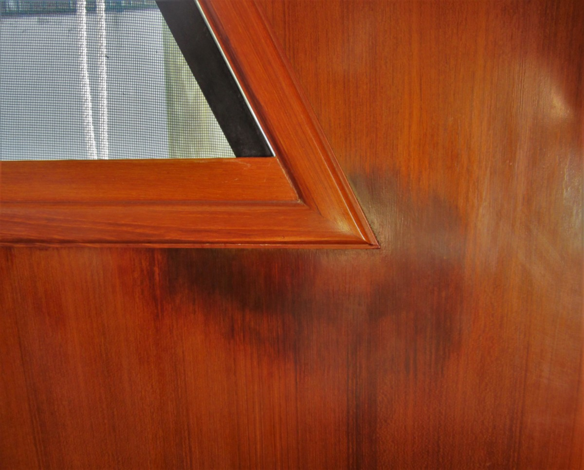 There has been a leak here for long enough to stain the veneer. The leak may not be from the window and may actually come from a piece of gear on the cabin top above. Veneer damage can be costly to repair.