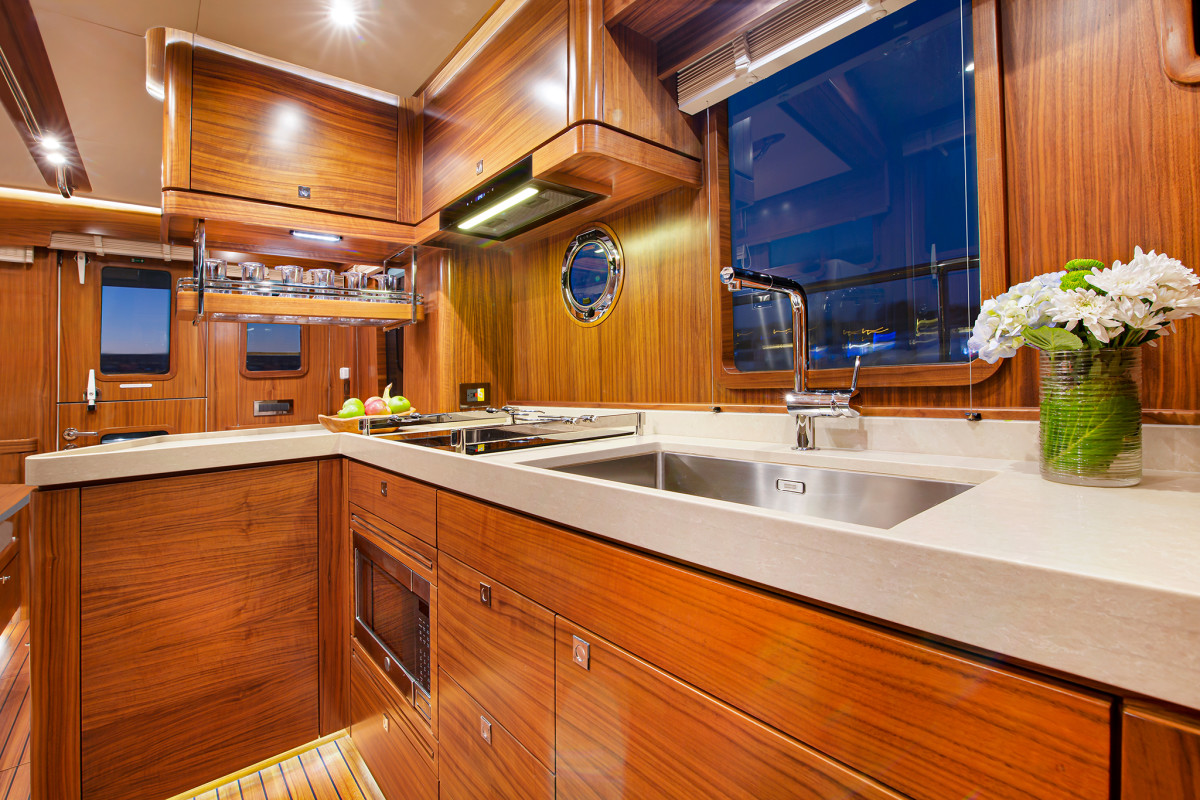 The galley features a large window for the chef, and the induction stove can run on battery power, so you can have your morning coffee without lighting off the genset.
