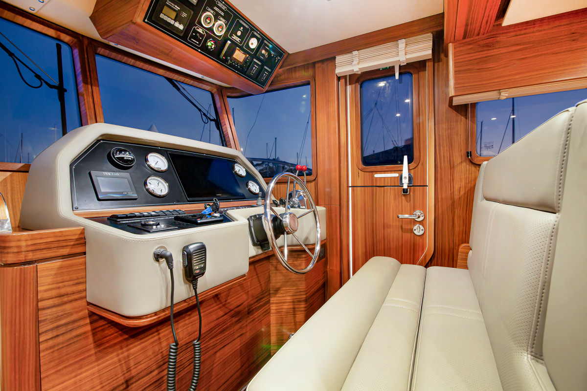 The hooded dash and reverse raked pilothouse windows prevent night reflections, and the dogging Dutch door provides easy deck access as well as a breeze.