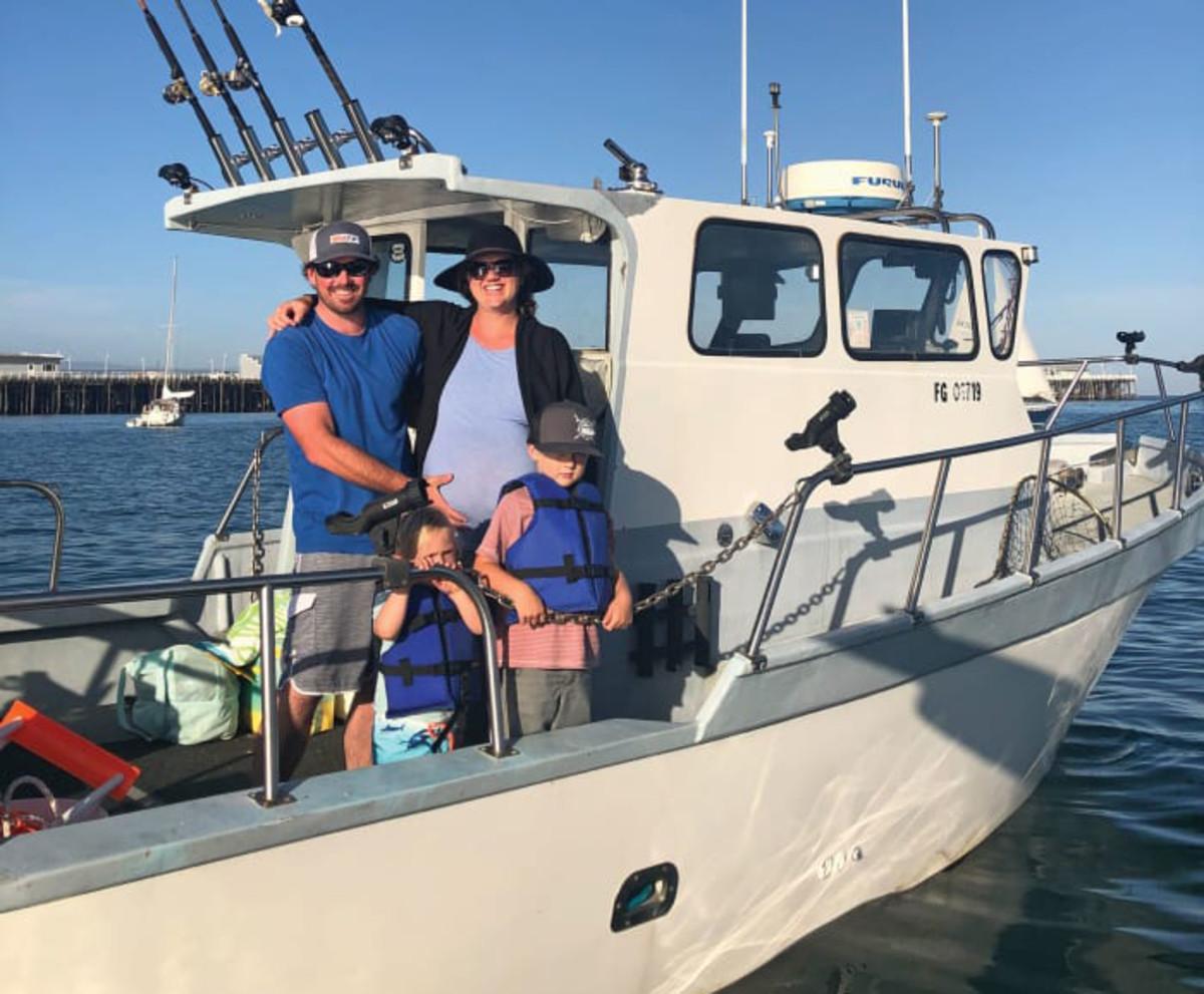 Santa Cruz, Calif., harbormaster Blake Anderson with his family on the harbor patrol boat.