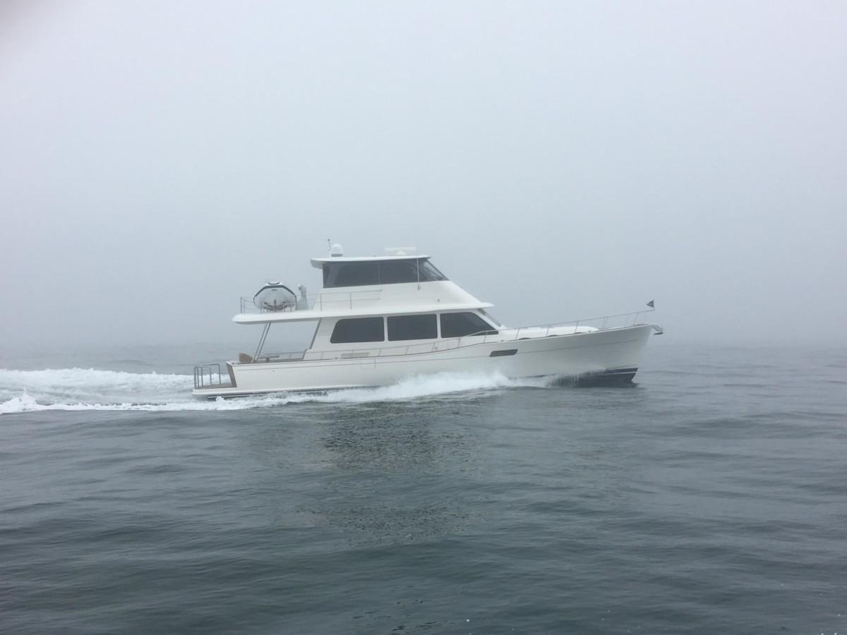Cruising cautiously through heavy fog on a Grand Banks 60.